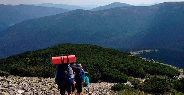 Trekking. Reaching the mountains peaks
